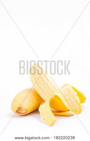 half peeled Lady Finger banana or golden banana   on white background healthy Pisang Mas Banana fruit food isolated