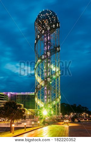 Batumi, Adjara, Georgia - May 26, 2016: Illuminated Alphabet Tower At Promenade Near Miracle Park, Amusement City Park On Blue Evening Or Night Sky Background. Modern Urban Architecture.