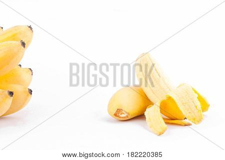 half peeled egg banana and  ripe Golden bananas  on white background healthy Pisang Mas Banana fruit food isolated