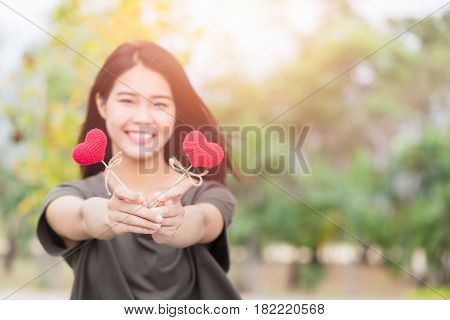 Giving Love , Asian Woman Hand Hold Give Beautiful Red Heart Sweet Loving Symbol Of Take Care Or Cha