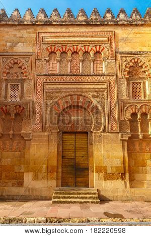 Puerta de San Juan - the third door of the east facade of the Great Mosque Mezquita, Catedral de Cordoba, in th sunny day, Cordoba, Andalusia, Spain