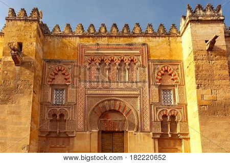 Puerta del Batisterio - the Fourth door of the east facade of the Great Mosque Mezquita, Catedral de Cordoba, in th sunny day, Cordoba, Andalusia, Spain