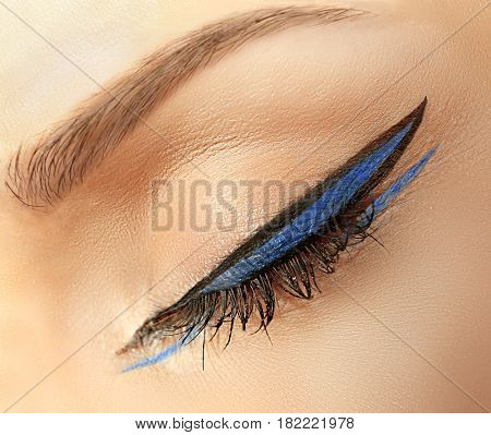Creative makeup with eyeliner, closeup