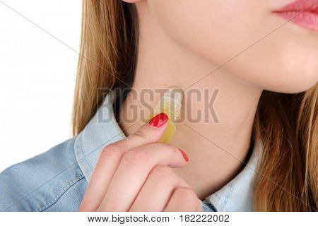 Young woman with bottle of perfume on white background, close up