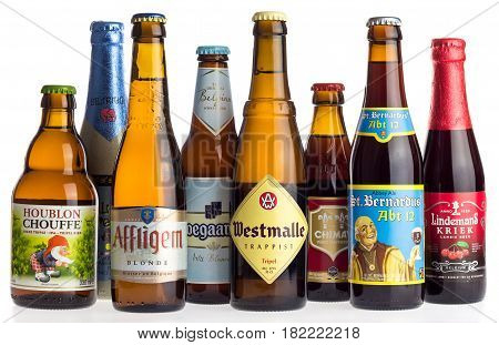 GRONINGEN, NETHERLANDS - APRIL 16, 2017: Collection of Belgian La Chouffe, Affligem, Hoegaarden, Westmalle, Delerium, Lindemans, Chimay and St. Bernardus beers isolated on a white background