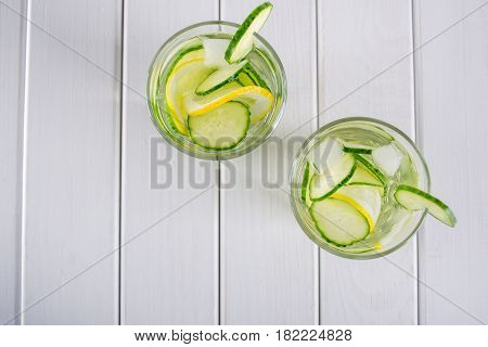 Refreshing  cucumber  cocktail, lemonade, detox water  in a glasses on a white background. Summer drink. Top view