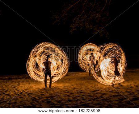 Man Fire Show on the beach with moving body ,Koh Kood ( Kood island ), Chanthaburi THAILAND
