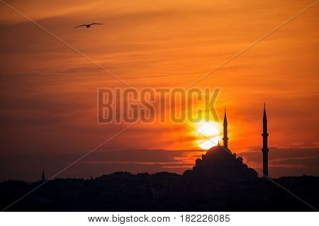 Mosque silhouette on The sunset and two minarets, copy space