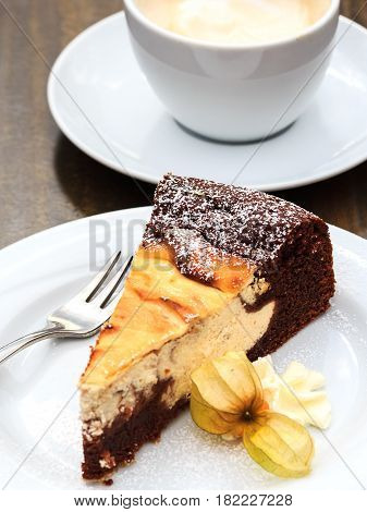 Cheese chocolate cake and a cup of cappuccino