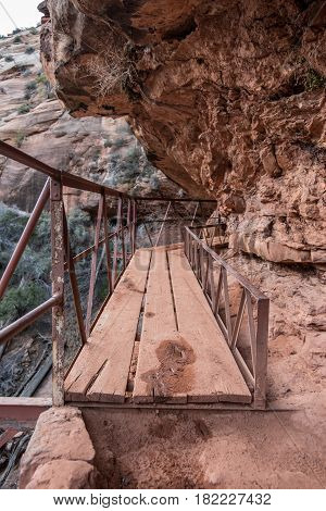 Precarious Plank Bridge On Cliff Connects Trails