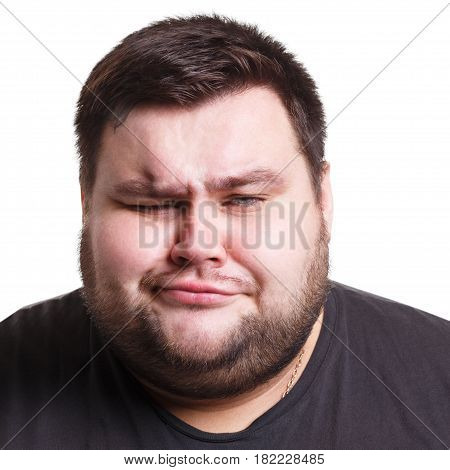 Feeling disgust. Man with unpleasant expression on face, negative emotion, white isolated studio background