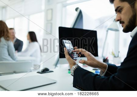 Accountant checking statistics of company profit on calculator