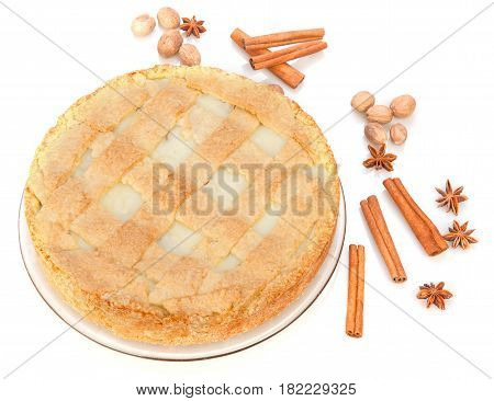 Apple pie with cinnamon anise nutmeg. Isolated on white background