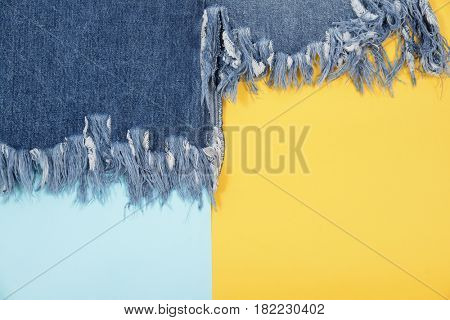 Blue denim skirt texture on blue and yellow background