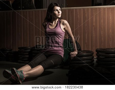 Modern young business woman next to a fitness machine at a fitness lesson in a fitness center