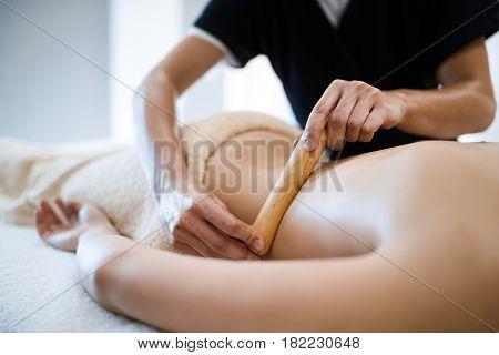 Thai massage therapist treating patient at healthcare salon