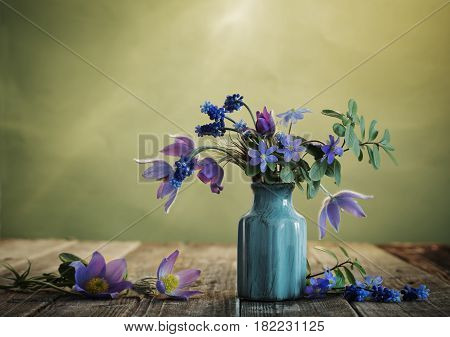 the still life with blue spring flowers