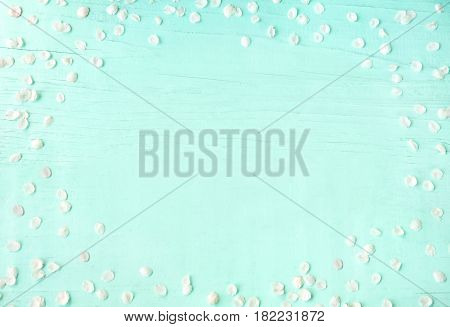 Amazing background With white petals of cherry blossoms lying on turquoise texture. Beautiful Web Banner With Copy Space. Card for invitation congratulation. Spring time