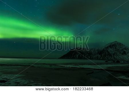 Aurora Borealis Known as Nother Lights Playing with Vivid Colors Over Lofoten Islands in Norway. Horizontal Image Orientation