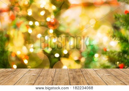 Blur Bokeh Christmas Light Background With Wood Floor