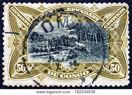 BELGIAN CONGO - CIRCA 1922: a stamp printed in Belgian Congo shows Railroad Bridge on M'pozo River circa 1922