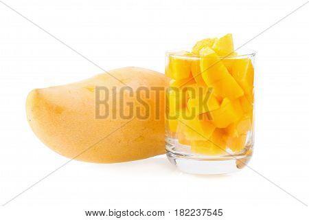 Mango fruit and mango cubes on the white background.