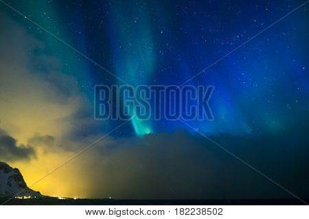 Aurora Borealis Known as Nother Lights Playing with Vivid Colors Over Lofoten Islands in Norway. Horizontal Image