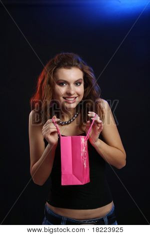A beautiful young lady holding shoppingbag