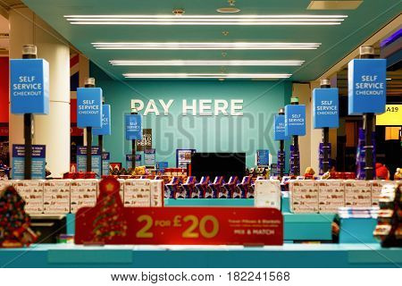 London UK - December 24 2016 - Duty free shop at Heathrow Airport with signs of PAY HERE and SELF SERVICE CHECKOUT