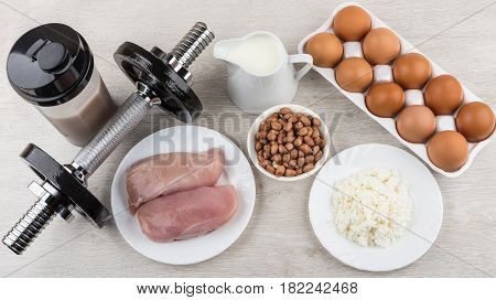 Dumbbells, Shaker With Drink And Food With High Protein Content