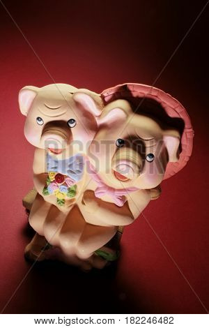 Pig Figurines on Red and Warm Background