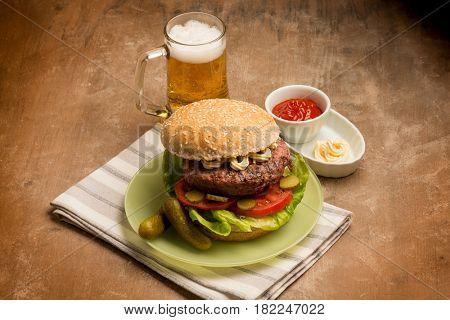big hamburger with glass of beer