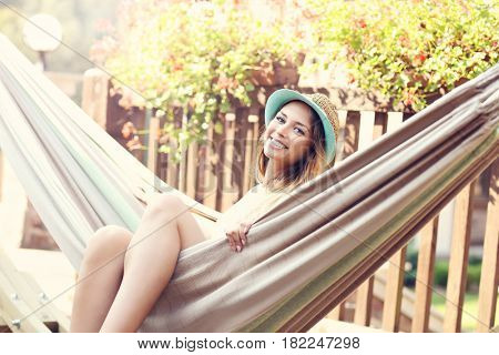 Relaxed woman resting on hammock