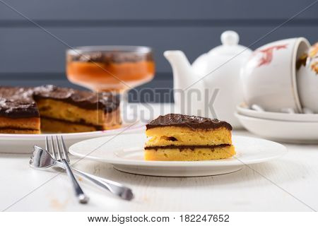 White faience teaware homemade low callorie pumpkin dessert and layered pumpkin cake with chocolate icing and forks
