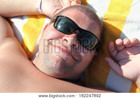funny tourist face in sunglasses - relax on beach