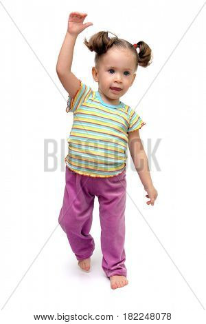 cute little girl dancing on white background