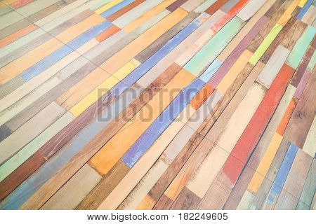 Colored horizontal rectangular tiled background with outlook on the diagonal yellow red white black pattern. Multicolor tiles