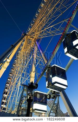 Cabins of Ferris Wheel and clear blue sky