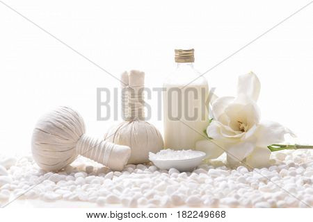 beautiful Gardenia's and spa ball ,oil, salt in bowl on pile of white stones,