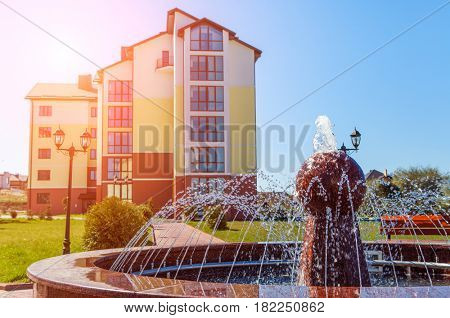 fountain on a background a house
