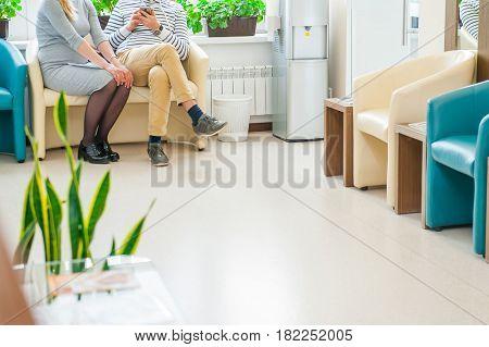 waiting room blue chairs door on the floor
