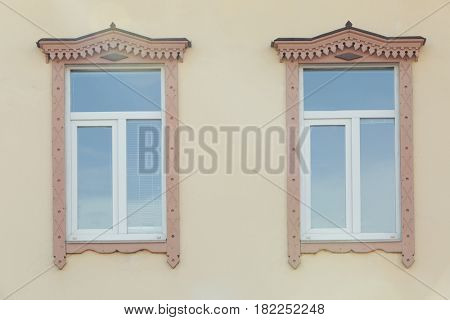Vintage windows with light wall background