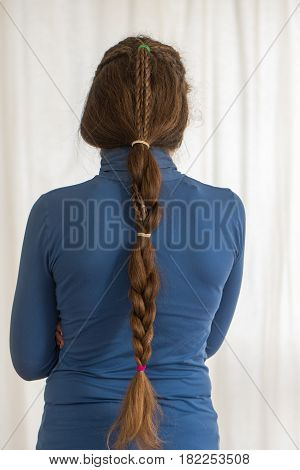 Teardrop English plait renaissance hairstyle for long hair. Traditional plait style modelled by girl with very long golden hair