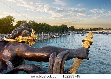 View on river Seine and nymph on the Alexandre III bridge in Paris, France