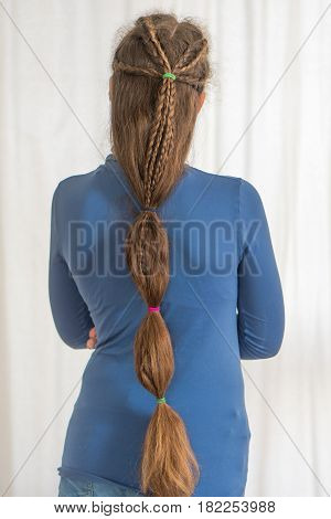 Teardrop plait renaissance hairstyle for long hair. Traditional plait style modelled by girl with very long golden hair