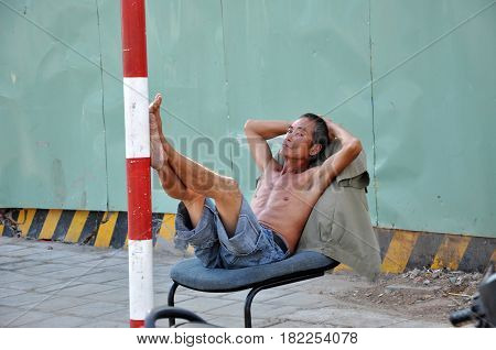 Vietnamese Man Resting In The Shadow