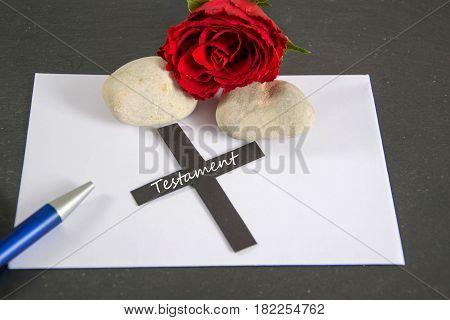 Testament - german for last will - written on a black cross