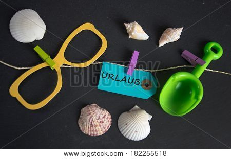 Urlaub - german for vacation -  written on paper tag
