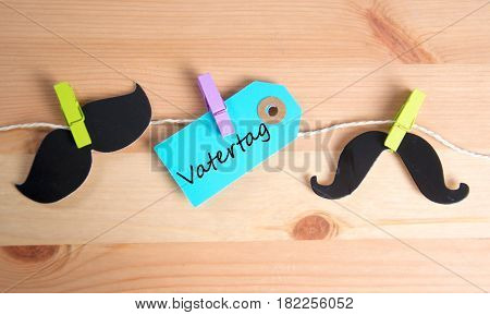 Vatertag  -  german for father`s day - written on a paper tag