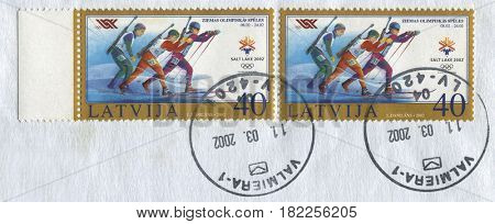 GOMEL, BELARUS, APRIL 17, 2017. Stamp printed in Latvia shows image of  The 2002 Winter Olympics, officially the XIX Olympic Winter Games and commonly known as Salt Lake 2002, circa 2002.